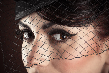 Face of beautiful model with black make-up closeup