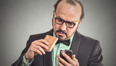 Worried Businessman with Smartphone